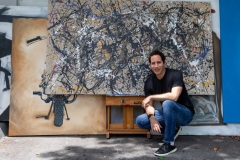 Patrick with paintings
